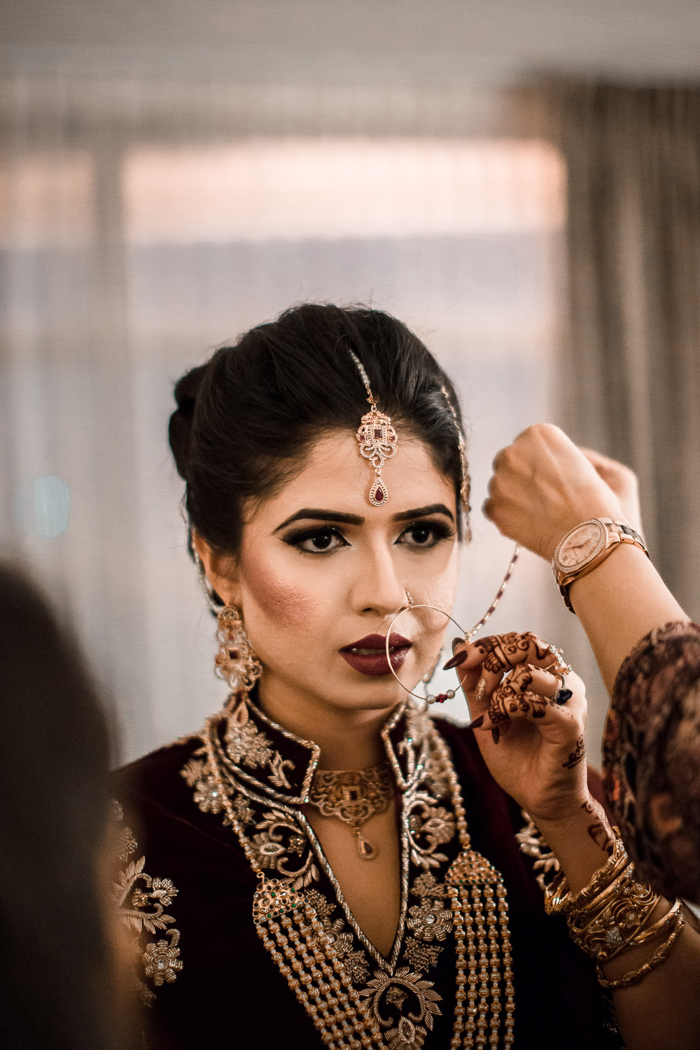 pakistani bride wearing Laung wedding nose piercing