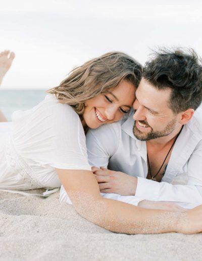 playful-intimate-beach-engagement-photos